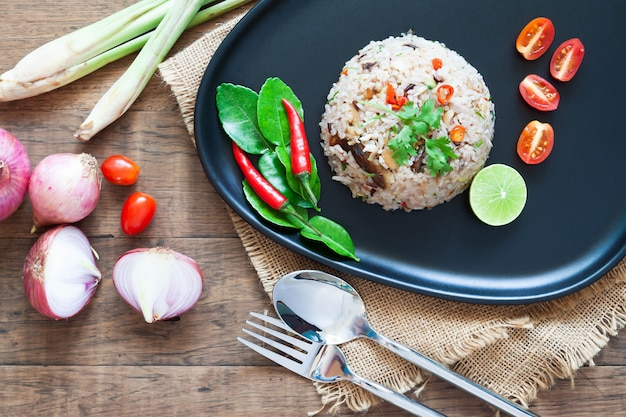 Special thai dish. fried rice with mackerel, chilli, lime leaves, onion and thai herbs. top view