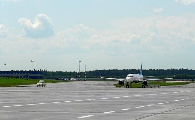 A special vehicle accompanies the plane to the runway.