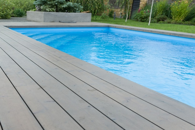 Special wooden board around the swimming pool
