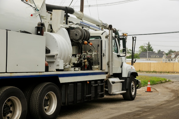 A specialized sewer cleaning machine works on a street.