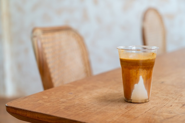 Specialty coffee menu called 'dirty coffee' . cold milk in the bottom with hot espresso shot on top in coffee shop cafe and restaurant