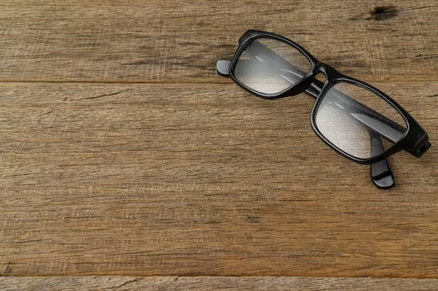 A spectacles on shabby wooden board.