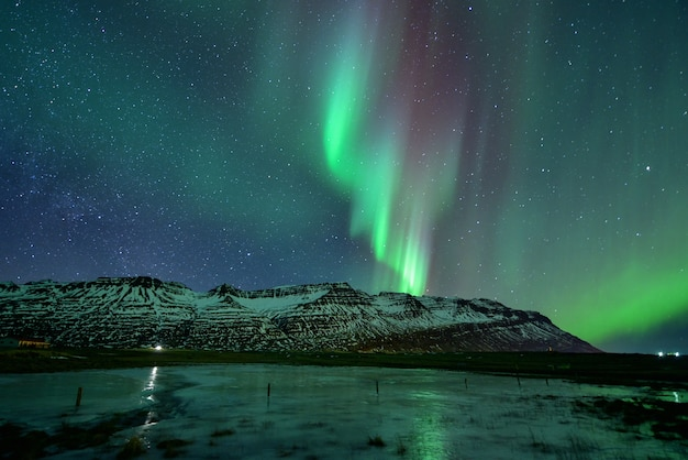 Spectacular auroral display at night over mountian, iceland