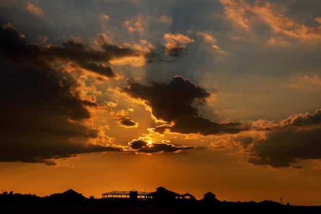 Spectacular sunset over urban area - landscape exterior