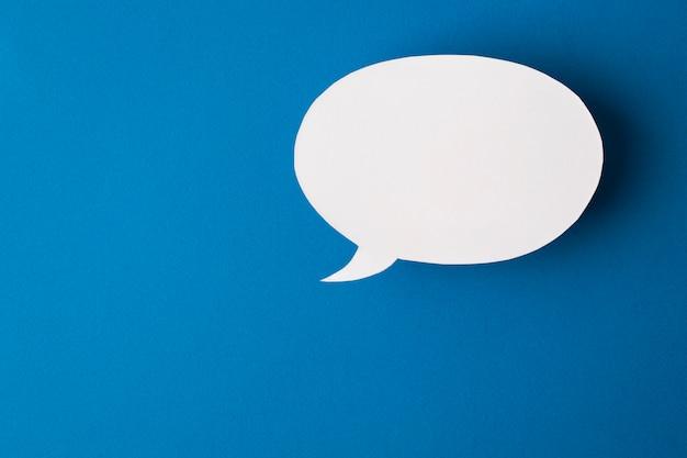 Speech bubble on blue