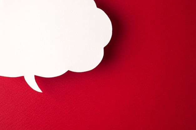 Speech bubble on red background