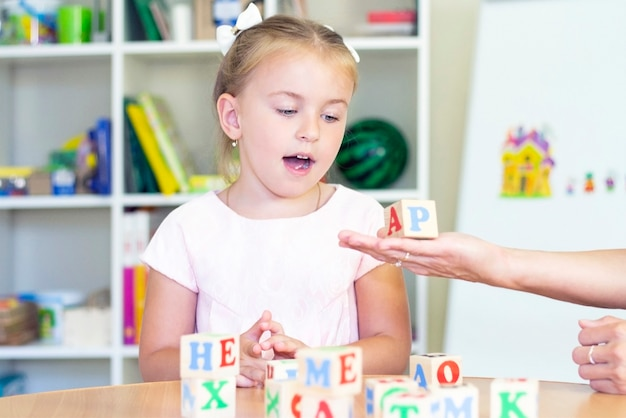 Speech therapy exercises and games with letters dice game