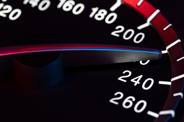 Speed detail with car odometer or tachometer macro shot