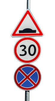 Speed hump, speed limit and no parking road signs isolated on white.