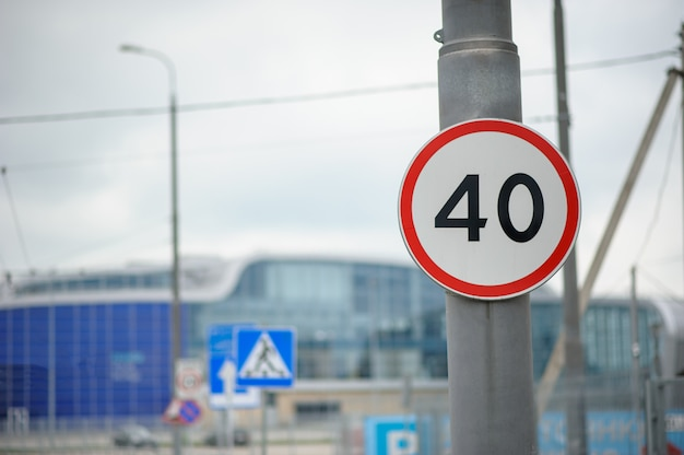 Speed limit sign at 40 kilometers per hour in front of the airport.