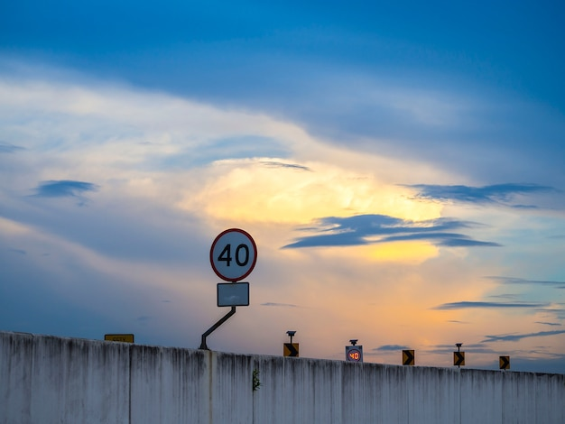 Speed limit sign do not exceed 40km/h on the bridge under dramatic sky