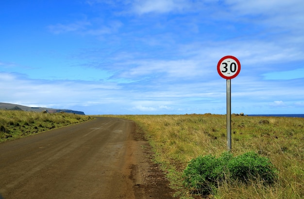 Speed limit signpost on the roadside of easter island, chile, south america