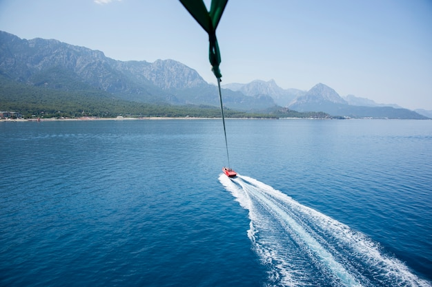 Speedboat with parachute