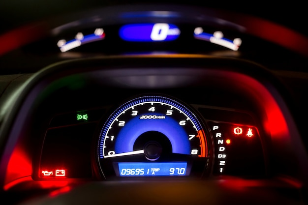 Speedometer of the car at night,modern interior in the car.