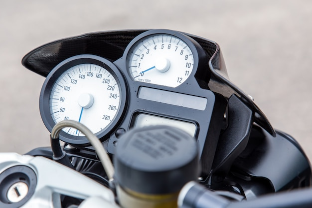 Speedometer on motorcycle dashboard.