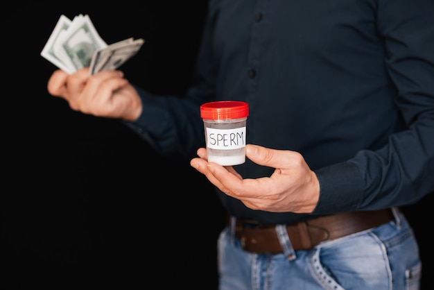 Sperm bank and money bills dollars in the hands