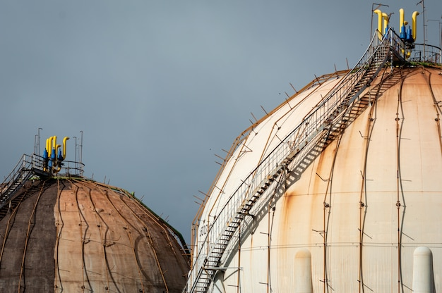 Spherical natural gas tank in the petrochemical industry in daylight