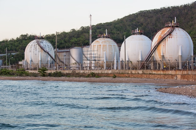 Spherical tanks containing fuel gas oil refineries next to the sea.
