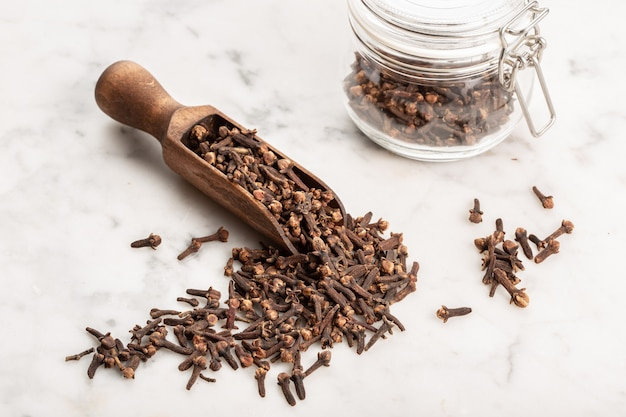Spice cloves on marble background