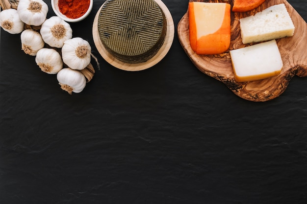 Spice and garlic near cheese