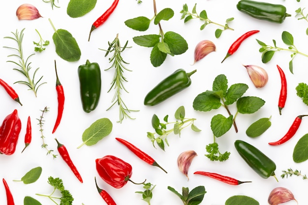 Spice herbal leaves and chili pepper on white. vegetables pattern. floral and vegetables on white. top view, flat lay.