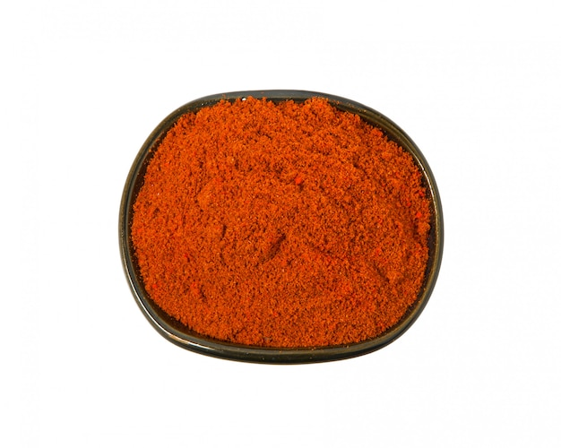 Spices in a clay dark bowl on a white background