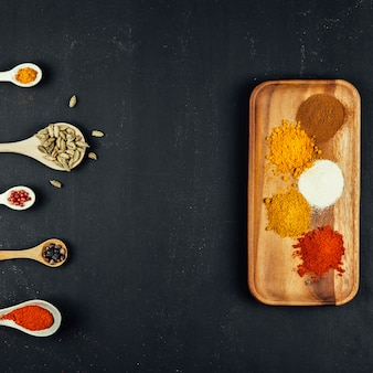 Spices composition with five spoons and board