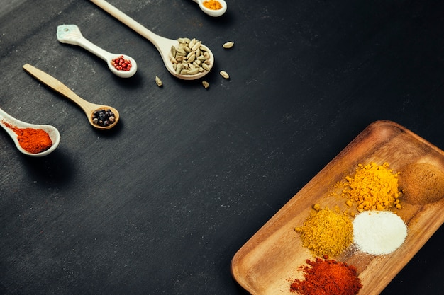 Spices composition with spoons and board