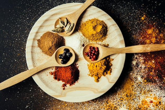 Spices decoration with wooden plate