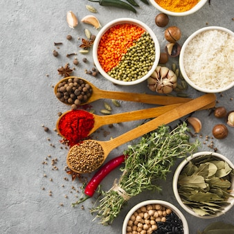 Spices and herb, rice and various beans with copy space on wite backgraund  top view