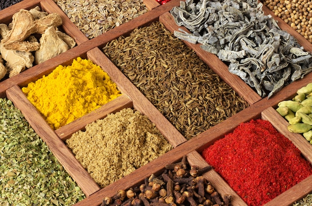 Spices and herbs in box on the market in asia. seasonings close-up as background.