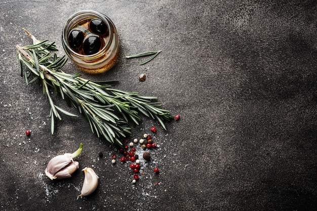 Spices and herbs on dark table