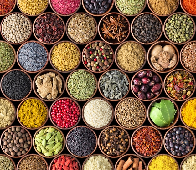 Spices and herbs isolated on black background