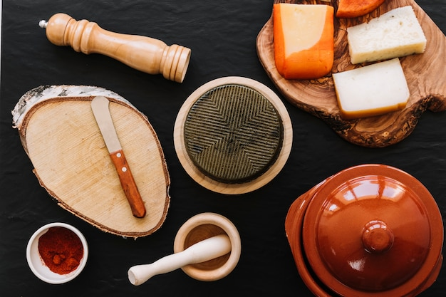Spices and knife near cheese
