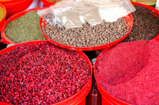 Spices on the market in colorful containers.