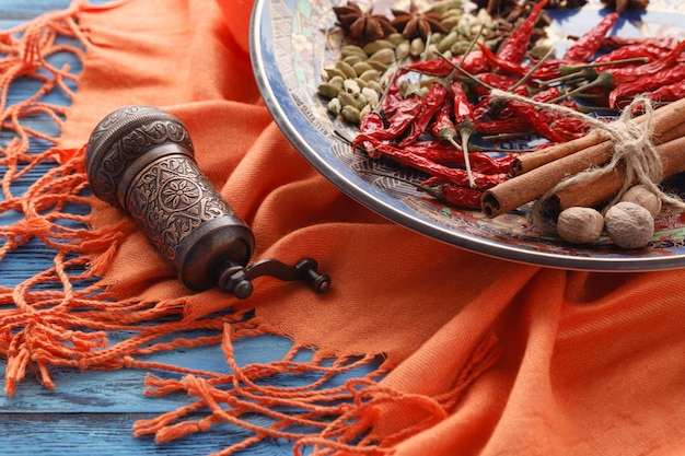 Spices mill and various aromatic herbs on plate