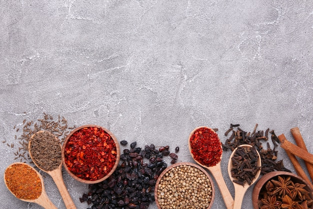 Spices mix on a grey background. top view