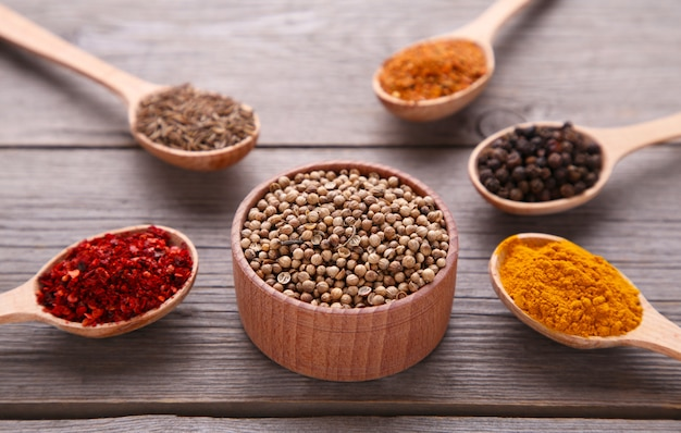 Spices mix on a grey wooden background. top view