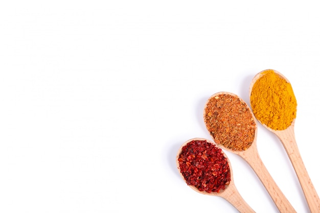 Spices mix on wooden spoons