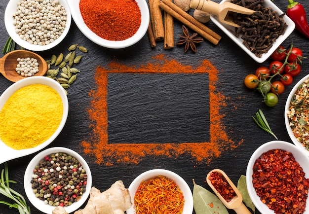 Spices powder and pieces on table