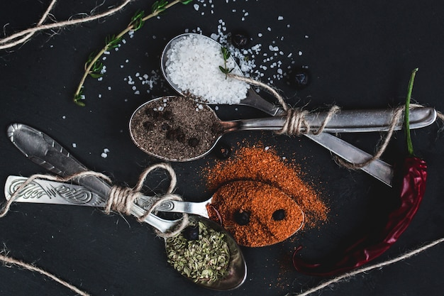 Spices in spoons top view. .