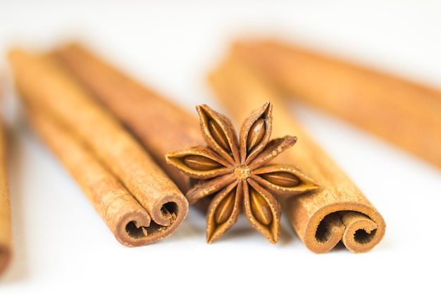 Spices: star anise and cinnamon sticks. close-up. blur
