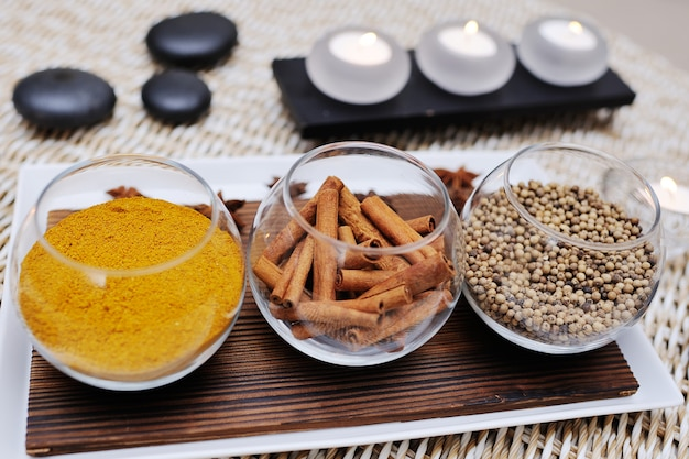 Spices - turmeric, star anise, cinnamon, cloves, allspice spa. aromatherapy, stone therapy.