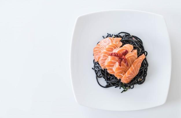 Spicy black spaghetti with salmon