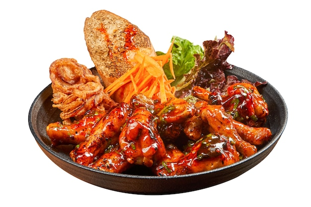 Spicy buffalo wings with bread and fried onions isolated side