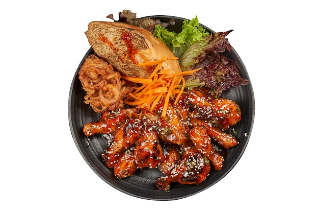 Spicy buffalo wings with bread and fried onions isolated