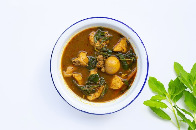Spicy chicken curry with thai southern chili paste on white wall