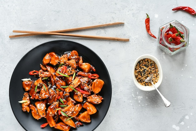 Spicy chicken in sweet and sour sauce with chili pepper.