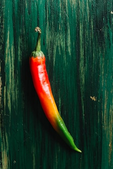 Spicy colourful hot chilli pepper on vintage background