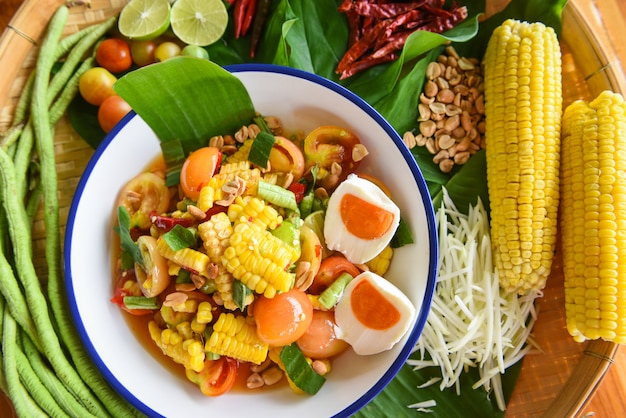 Spicy corn salad with fresh vegetables herbs